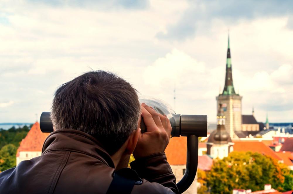Anonymous,Tourist,Looking,Through,Observation,Binocular,Glasses,In,Tallinn.