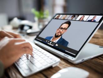 Man,Having,Online,Group,Videoconference,On,Laptop